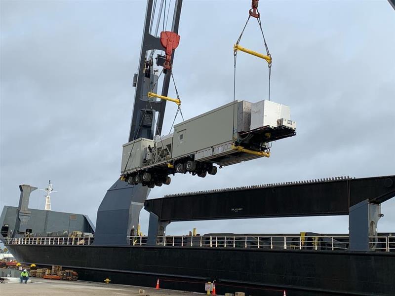 crane loading turbine onto ship