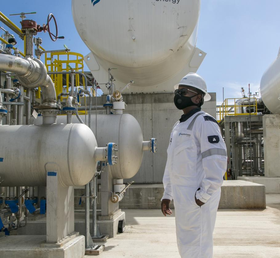 New Fortress Energy employee with mask at terminal